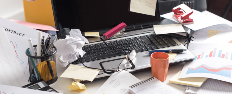 visual image of messy office desk